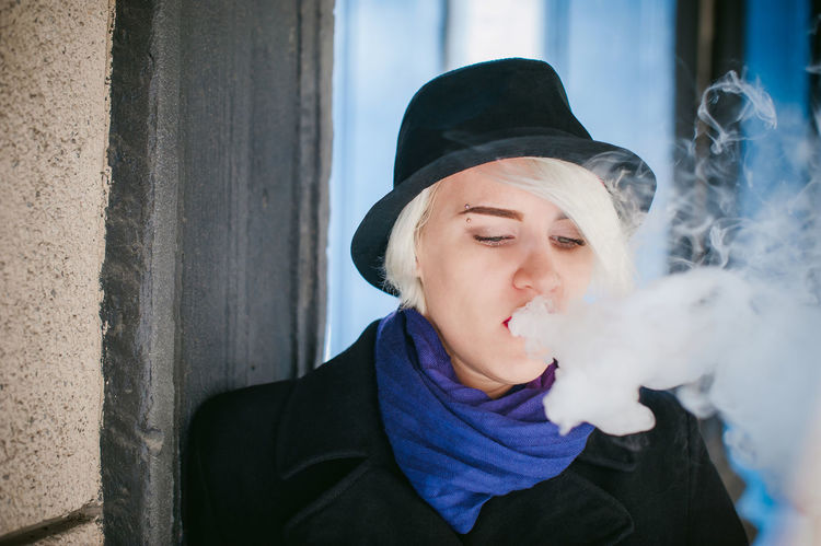 Addiction Bad Habit Cap Close-up Day Front View Headshot Holding Leisure Activity Lifestyles One Person Outdoors Portrait Real People Smoke - Physical Structure Smoking - Activity Smoking Issues Vape Young Adult Young Women