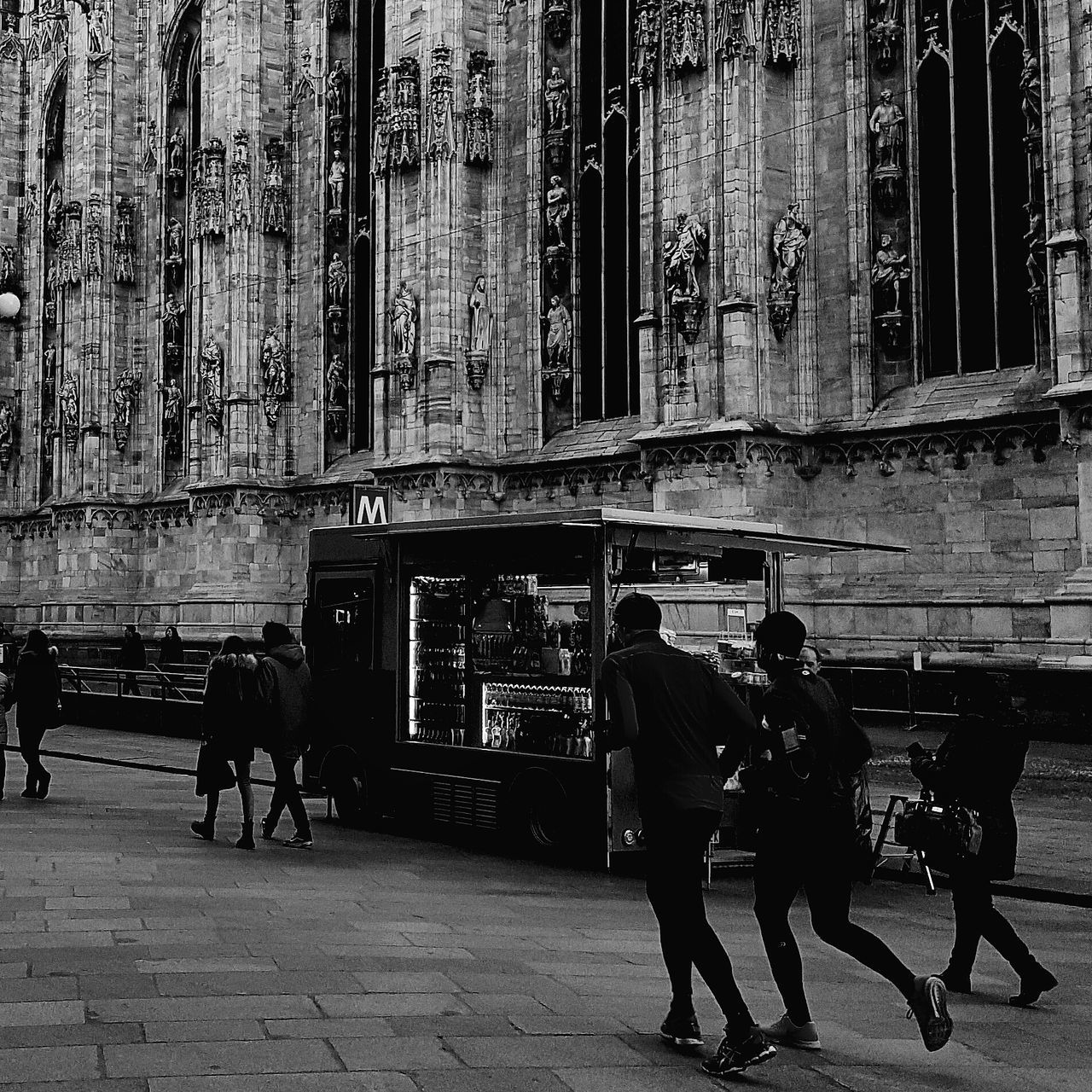 men, real people, built structure, architecture, day, building exterior, full length, place of worship, lifestyles, women, outdoors, mammal, people