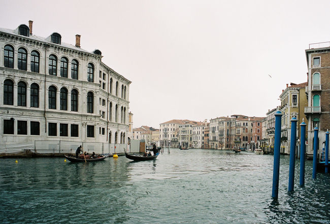 35mm 35mm Film Analogue Photography Portra 400 Venice, Italy Analog Architecture Building Exterior Built Structure Canal Clear Sky Day Gondola Gondola - Traditional Boat Gondolier Mode Of Transport Nature Nautical Vessel Oar One Person Outdoors People Real People Rowing Sky Transportation Travel Travel Destinations Water Waterfront Wooden Post Your Ticket To Europe
