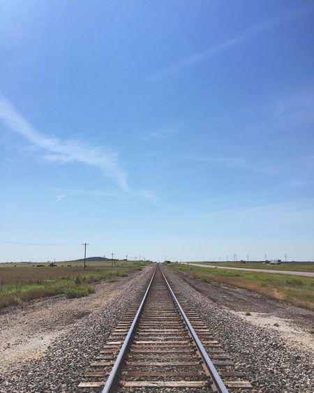 Railroad Tracks Against Blue Sky
