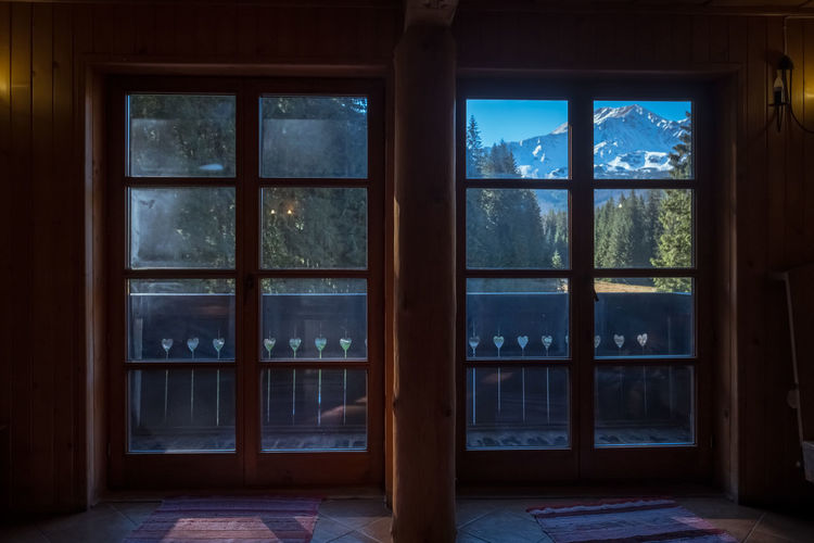 Another epic view Mountain View Rustic Architecture Building Built Structure Day Domestic Room Door Epic View Flooring Glass - Material House Indoors  Mountain Mountain Hut Nature No People Plant Transparent Tree Window Window Frame Wood - Material