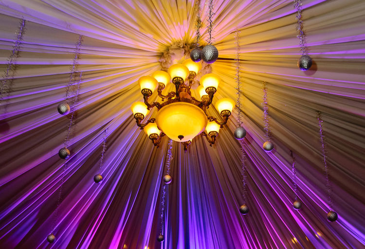 Ceiling decor for wedding Ceiling Chandelier Wedding Low Angle View Lighting Equipment Indoors  No People Decoration Illuminated Pattern Architecture Built Structure Hanging Light Art And Craft Design Multi Colored Ornate Building Electricity  Pink Color Electric Light Purple Luxury Directly Below Electric Lamp Floral Pattern