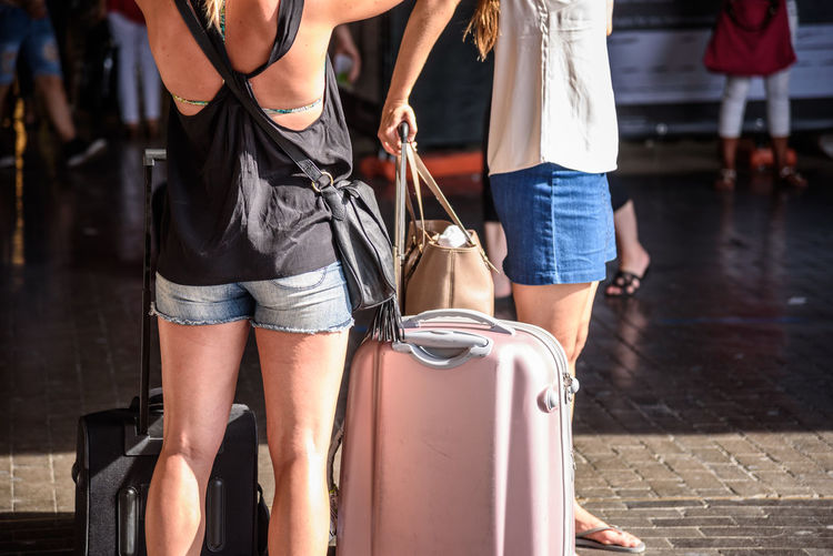 Casual Clothing Close-up Day Fashion Focus On Foreground Human Leg Incidental People Leisure Activity Lifestyles Low Section Luggage Men One Person Outdoors Purse Real People Standing Suitcase Walking Women