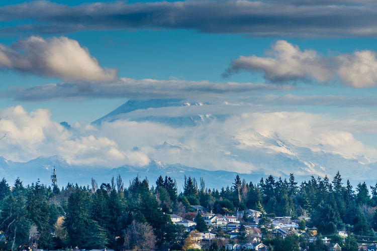 Clouds cover Mount Rainier with homes in the foreground. Cloud - Sky Tree Sky Plant Scenics - Nature Beauty In Nature Nature Architecture No People Tranquil Scene Day Tranquility Built Structure Building Exterior Building Outdoors City Idyllic Landscape Mount Rainier Mountain Homesweethome