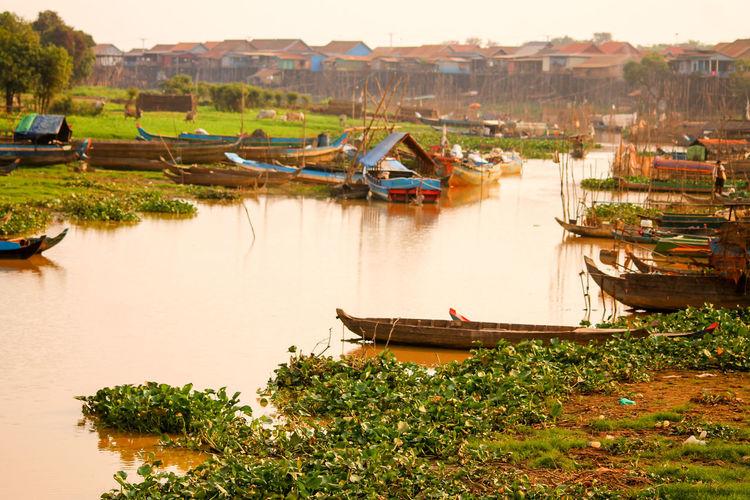 Boats moored at riverbank