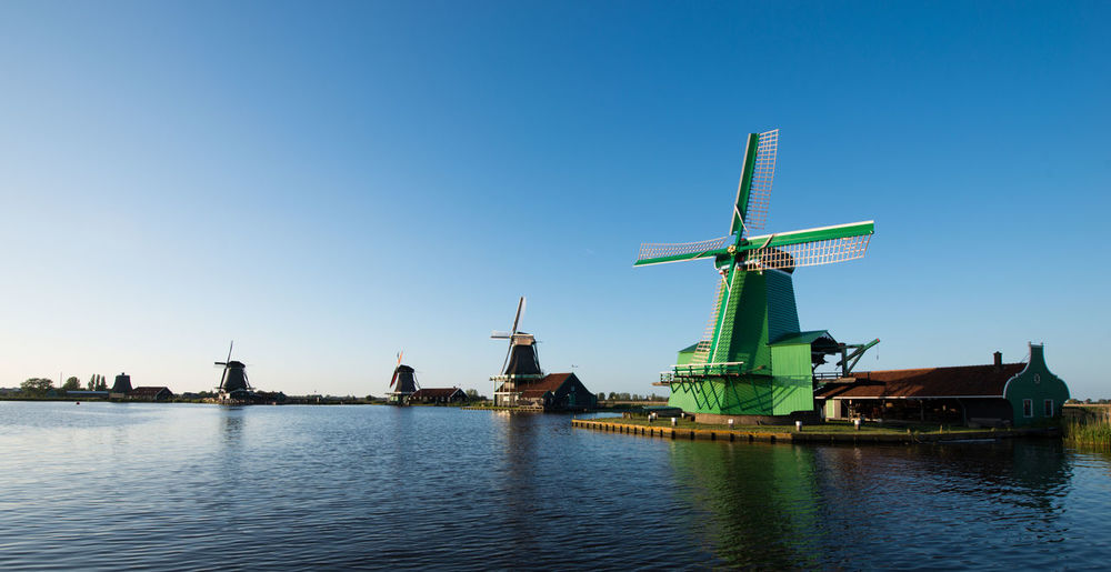 Zaanse schans, Holland - Traditional Dutch windmills with canal close Blue Boat Day Environmental Conservation Mast Mode Of Transport Nature No People Outdoors Renewable Energy Sailboat Sailing Sky Wind Power Windmill