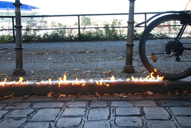 Bike Burning Day Metal No People Outdoors Sky Water CyclingUnites Hot Fire Fast Motion Speed Fun