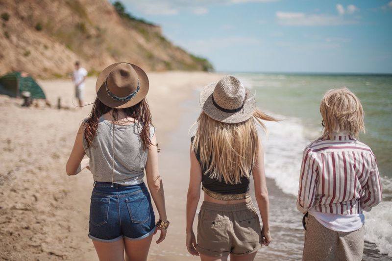 Beach Friendship Rear View Vacations Casual Clothing Sea Sand Happiness Walking Relaxation Summer Togetherness Enjoyment Leisure Activity Lifestyles Fun Outdoors Women People Weekend Activities Fashion Style Beachphotography Young Women Friends