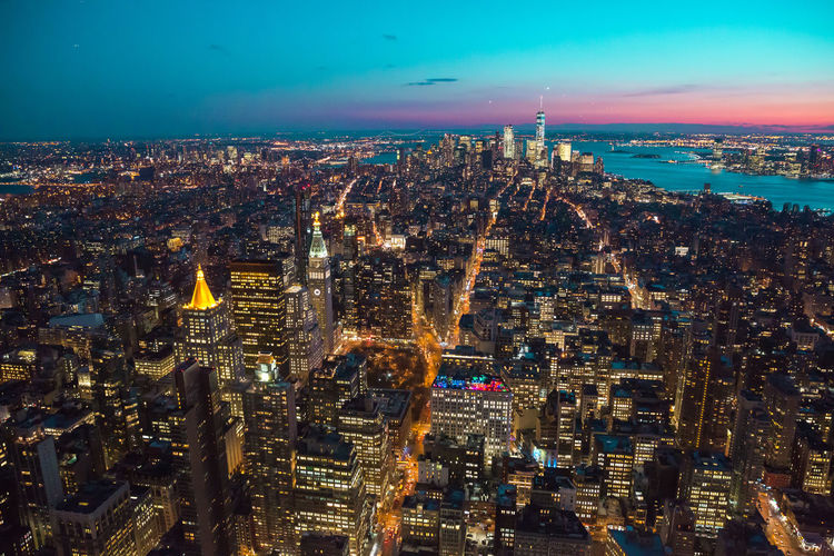 Aerial View Architecture Building Exterior Built Structure City City Life Cityscape Crowded Development Growth High Angle View Illuminated Modern Night Outdoors Sky Skyscraper Tall Travel Destinations Urban Skyline