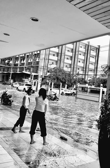 Flooding Real People Architecture Built Structure Day Standing Full Length Building Exterior Water Women Men Outdoors Vientiane Laos ASIA Streetphotography Monochrome Photography Borpenyang Iphonephotography City Life Rain
