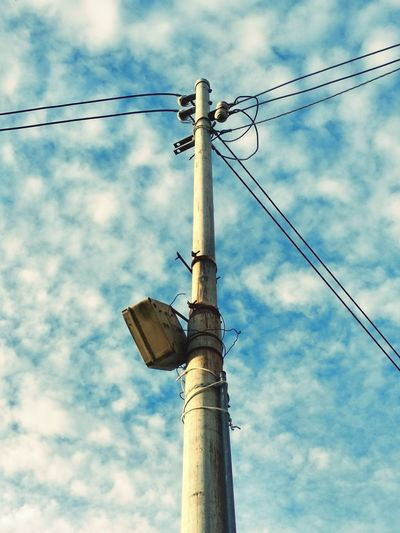 Utility pole with cloudy sky background. Electric Grid Utility Pole Sky Clouds Power Line  Electricity Pole Telephone Pole Clouds And Sky Electricity  Electricity Pylon Power Supply Power Line