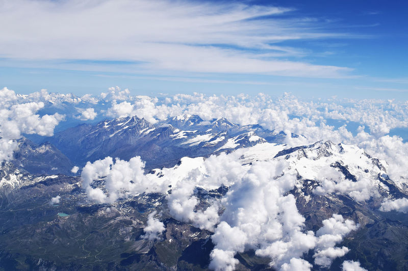 High angle view of snowcapped mountain against sky
