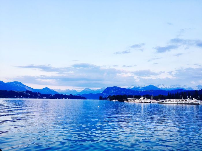 Lakeside @ Lake Lucerne Water Mountain Sky Scenics Tranquility Beauty In Nature Tranquil Scene Nature No People Waterfront Mountain Range Outdoors Blue Cloud - Sky Lake The Great Outdoors - 2017 EyeEm Awards Lake Lucerne