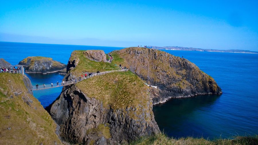 Carrick-a-Rede Rope Bridge Water Sea Beauty In Nature Scenics - Nature Horizon Over Water Blue Sky Nature Outdoors