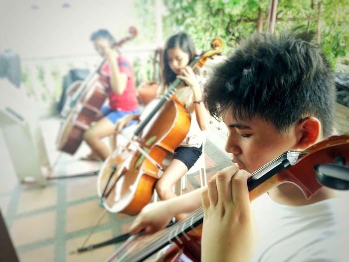 Teenagers playing violins