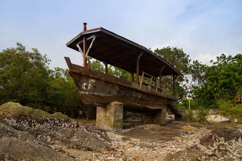 Exterior of abandoned boat against sky