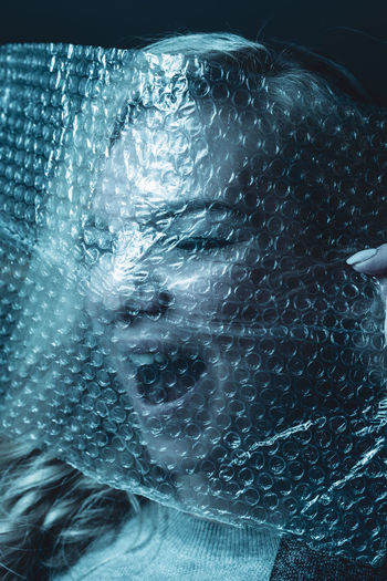 Close-Up Portrait Of Woman With Bubble Wrap