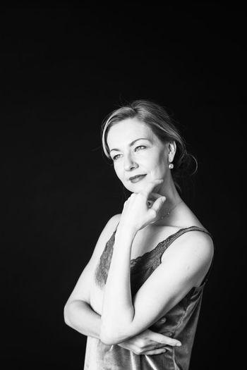 Beautiful mature woman against black background