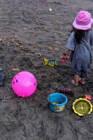 Color Bandung Shooter Indonesian Shooter Beach Casual Clothing Child Childhood Day Females Girls Hat High Angle View Innocence Leisure Activity Lifestyles Multi Colored Offspring One Person Real People Sand Pail And Shovel Toy Warm Clothing Water Women