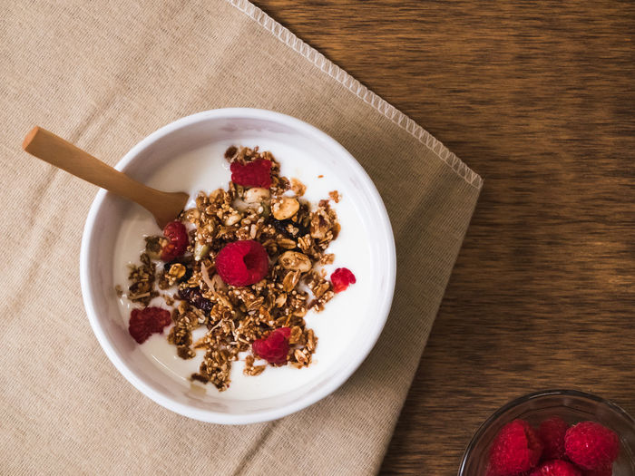 Bowl Breakfast Composition Food Food And Drink Good Morning Healthy Eating Healthy Food Healthy Lifestyle Indoors  Indulgence Morning Morning Rituals Overhead View Preparation  Raspberry Ready-to-eat Sweet Food Table Top Perspective View From Above Wooden Yogurt