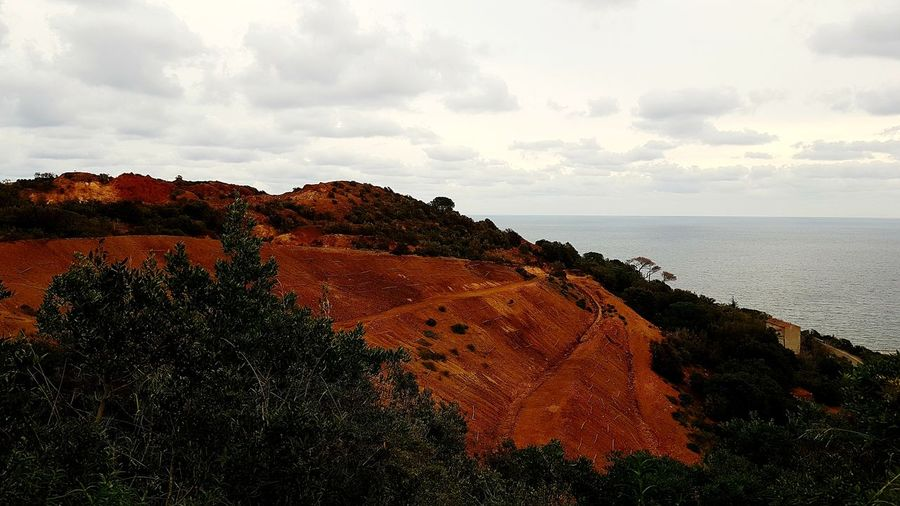 Mineral park Red Earth Iron Mine Mineral Mines Red Color Minesviewpark Nature Vacations Elba Island  Italy Water Sea Beach Sky Horizon Over Water Landscape Cloud - Sky Geology Physical Geography Eroded Rock Formation Natural Landmark