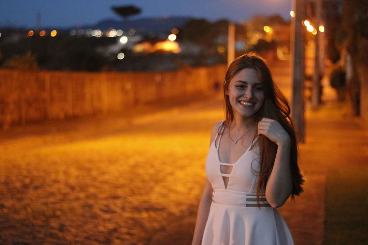 Beautiful Woman Cheerful Focus On Foreground Happiness Illuminated Lifestyles Looking At Camera Nature Night One Person Outdoors People Portrait Real People Smiling Young Adult Young Women