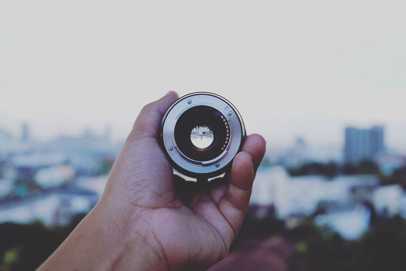 EyeEm Selects Human Hand Human Body Part Focus On Foreground Holding Personal Perspective One Person Close-up Real People Outdoors Photography Themes Day Camera - Photographic Equipment Photographing Architecture Sky City Cityscape Nature People