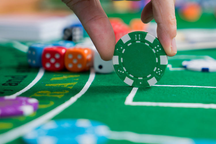 Arts Culture And Entertainment Casino Close-up Finger Gambling Gambling Chip Hand Human Body Part Human Hand Human Limb Leisure Activity Leisure Games Luck Number One Person Playing Pool Table Real People Relaxation Selective Focus Sport Table