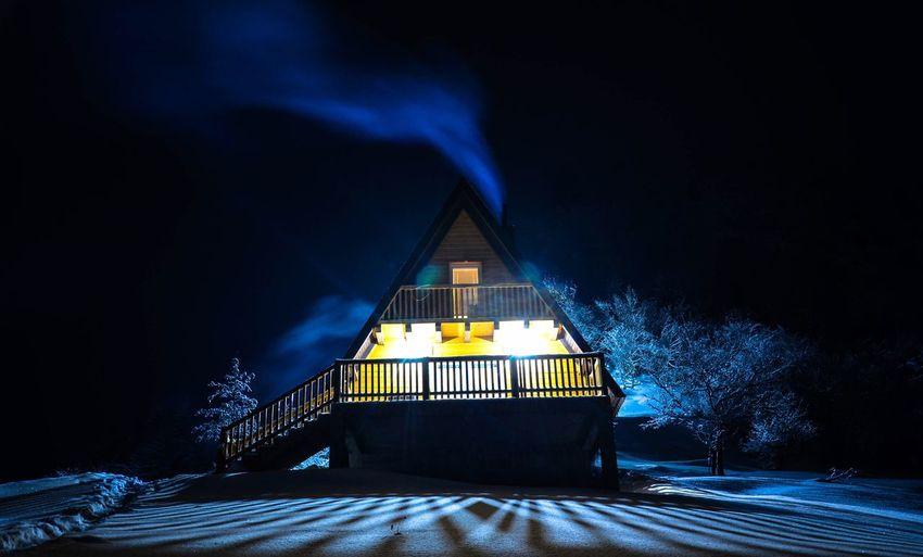 Illuminated building at night during winter