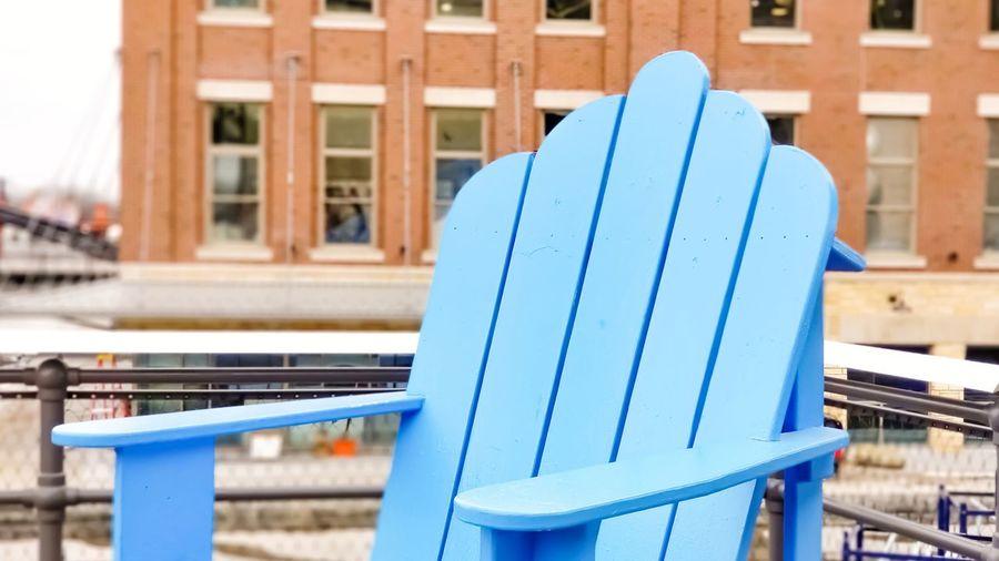 Empty blue adirondack chair