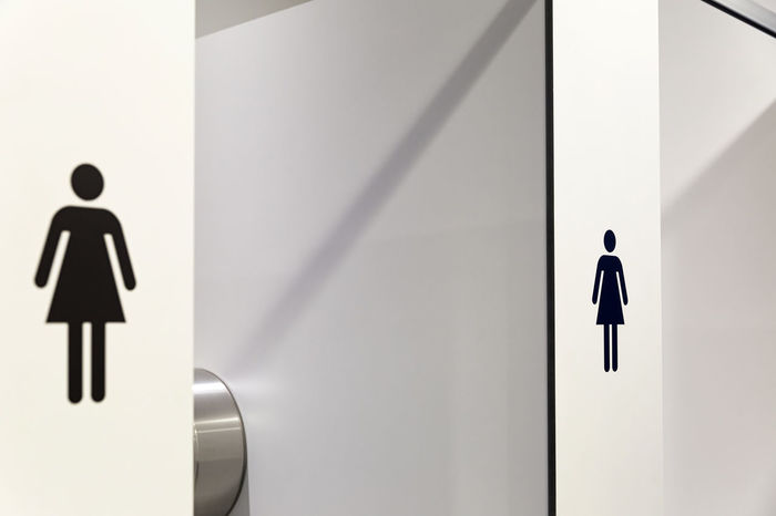 In an public building are women's toilets with white doors and Female Symbol Decals Architecture Architecture_collection Architecturelovers Clean Cleaning Decal Interior Interior Design LINE Lines And Shapes Sign Signage SignSignEverywhereASign Sings Symbol Symbolism Wc White Woman Women