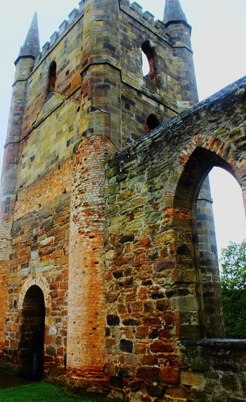 Arch Architecture Australia Built Structure Castle Day History History Architecture Low Angle View No People Old Ruin Outdoors Past Place Of Worship Port Arthur Religion Sky Spirituality Tasmania TasmaniaAustralia The Past Travel Destinations