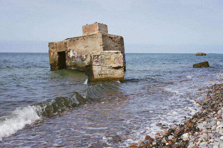 Built structure on sea shore against sky
