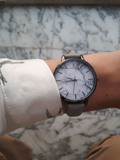 Cropped image of hand wearing wristwatch
