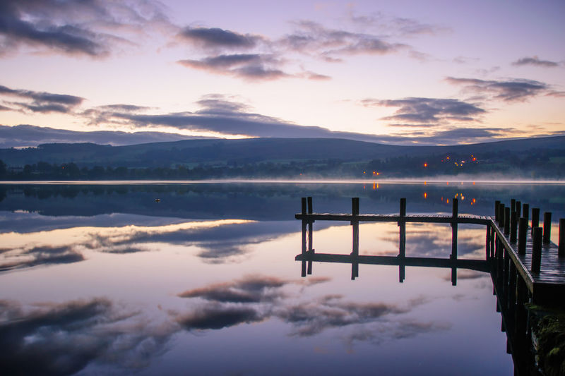 Lake District Ullswater Beauty In Nature Cloud - Sky Idyllic Lake Mountain Nature No People Non-urban Scene Outdoors Pier Post Reflection Scenics - Nature Sky Standing Water Sunset Tranquil Scene Tranquility Water Waterfront Wood - Material Wooden Post