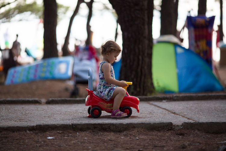 Camping Childhood Day Enjoyment Focus On Foreground Full Length Fun Girl Happiness Leisure Activity Live For The Story One Person Outdoors People Playground Playing Real People Ride Side View Sitting Summer Toy Toy Car