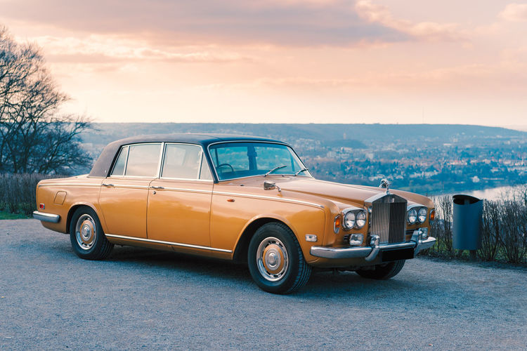 Lovely Rolls Royce car glooms in the sunset Drachenfels Sundown Shimmering Transportation Mode Of Transportation Land Vehicle Motor Vehicle Car Retro Styled Sky Vintage Car Road Stationary No People Cloud - Sky Day Collector's Car Pick-up Truck Nature Outdoors City Parking