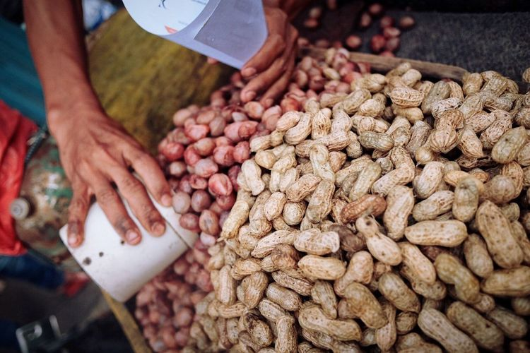 Blissful snack Human Hand Food Food And Drink Retail  Market Close-up Human Body Part Market Stall Freshness Variation For Sale Choice Indoors  Day People Peanuts Streetfood INDONESIA It's About The Journey