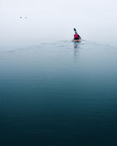 Mid Distance Of Person Kayaking On Sea