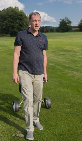 Golf player at tee off on a golf course Barky Golf Course Golf Ball PUTT Tee Ace All Square Ball Sports Caddie Chip Club Clutch Position Golf Bag Golf Club Golf Player Golf Road Golf Round Golf Rules Golfer Handicap Hitting Hole Putter Reduction Sandy Obstacle