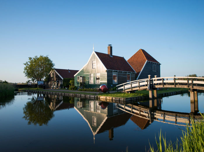 Zaanse schans, Holland - Traditional Dutch village Architecture Beauty In Nature Blue Built Structure Calm Canal Clear Sky Day Growth Idyllic Nature No People Outdoors Reflection Scenics Sky Standing Water Tranquil Scene Tranquility Tree Water Waterfront