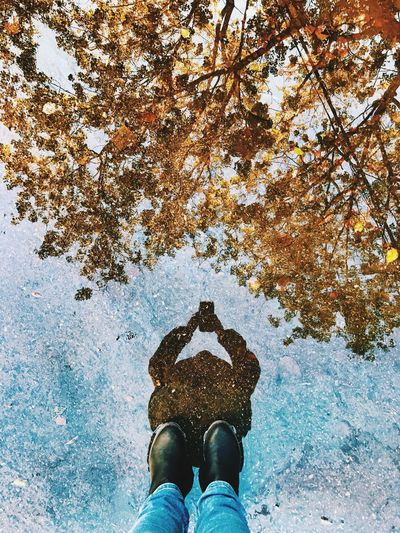 Puddle Puddleography Puddle Reflections Adapted To The City מייסטריט Personal Perspective The Street Photographer - 2017 EyeEm Awards One Person Real People Shoe Human Body Part Autumn Lifestyles Men Day Leisure Activity מייחורף Outdoors Tree Nature Sky Water IPhone7Plus מייאייפון7 Shotoniphone7plus Shades Of Winter