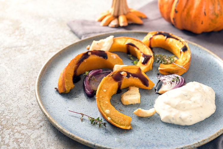 High angle view of pumpkins in plate on table