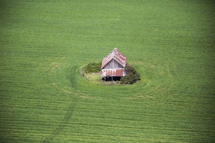 High angle view of traditional building on field