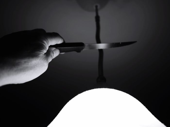 CUTTING IT JUST ABOUT IN THE MIDDLE ◼️🔳🔳🔳◼️ Art Performance Black And White Photography Knife Human Hand Hand Indoors  Lighting Equipment