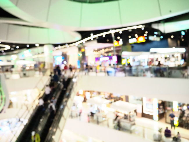 Blurred interior of shopping mall. The modern building concept. Incidental People Illuminated Group Of People Real People Transportation Architecture Large Group Of People Lighting Equipment Crowd Indoors  Market Retail  Store Mode Of Transportation Travel City Walking Shopping Public Transportation Business Consumerism