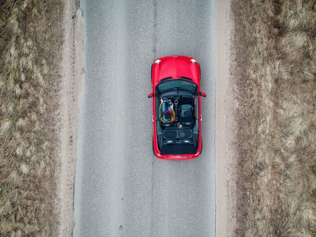 Mini Cooper cabrio from a birds eye view perspective Mini Cooper MiniCooper Mini Convertible Cabrio Day Red Textured  High Angle View Wall - Building Feature No People Directly Above Transportation Road Outdoors