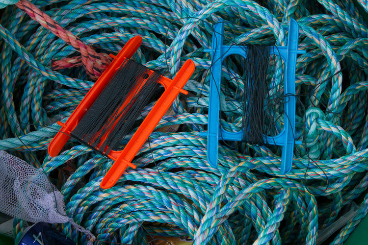 Fishing Ropes, Cords and Lines jumbled together Backgrounds Blue Cable Choice Close-up Complexity Connection Day Fishing Industry Fishing Net Full Frame Green Color High Angle View Indoors  Large Group Of Objects No People Rope Still Life Tangled Thread Turquoise Colored