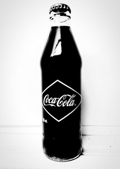 reproduction of a vintage Coke bottle. Taking Photos Glass Coca Cola Western Script Black And White Text CursiveText WesternScript Check This Out No People No People! Refreshing Drink Refreshing Coca-cola Coke, It's The Real Thing Coke Adds Life Coca~Cola Labeling Drink Coca~cola ® Reproduction Blackandwhite Cocacola Coca~cola Caffeine Coca-Cola, Label/logo/sign Coca-cola Coke Coke Bottle CokeBottles Coca~Cola ® Close-up Soda