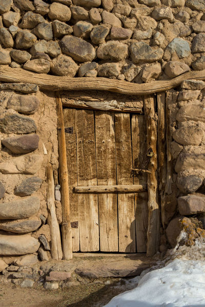 The small village of Kandovan near to Tabriz, Northern Iran. Also known as Irans Cappadocia due to its unique rock formations that locals and caved out and used as their homes for hundreds of years. Cappadocia Kandovan Architecture Building Building Exterior Built Structure Day Door Entrance History No People Old Outdoors Rock Rock - Object Solid Stone Material Stone Wall The Past Wall Wall - Building Feature Wood - Material